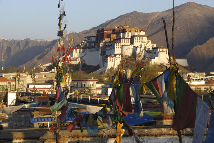 Prayer flags hanging against clear sky