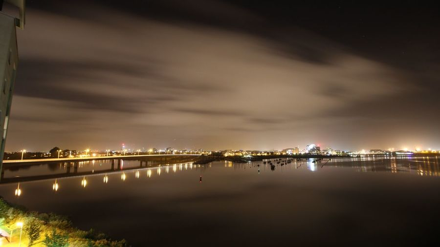 Cardiffbay Illuminated Reflection Water Sky Waterfront Night River Scenics Tranquil Scene Cloud - Sky Tranquility Standing Water Atmospheric Mood No People Beauty In Nature Harbor Sea Cloudy