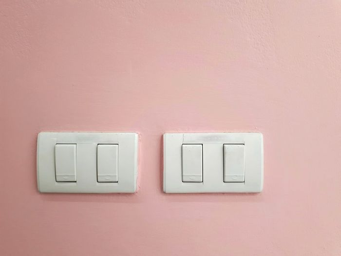 Close up switch on pink background, light switch, electricity, electronics, design, home, copy space, work, pastel, on-off, detail, creative, switch lamp, minimal, pink color, house, interior design, save, power, Minimalism Minimal Pastel Pink Color Background Industry Architecture Indoors  Electricity  Electric Lamp Copy Space Copyspace Work Office Open Power Lines&Design Energy Choice Electricity  Close-up Light Switch Switch Turning On Or Off Electrical Component Mother Board Audio Electronics Outlet Electricity Pylon Information