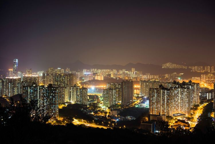 High Angle View Of Illuminated City Against Clear Sky