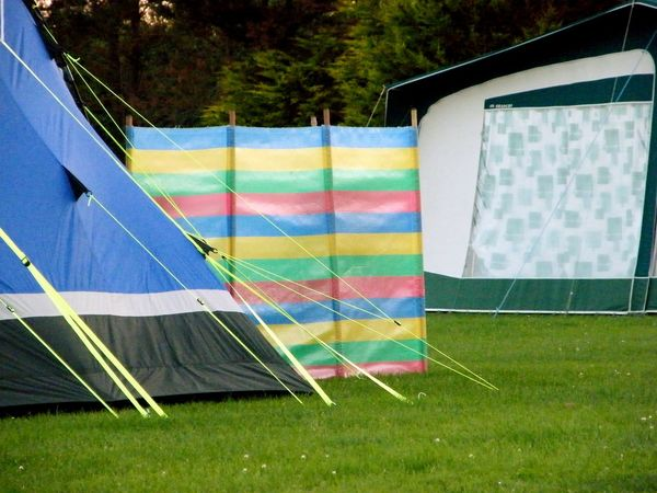Absence Blue Camp Site Camping Camping Life Colorful Day Empty Grass Grassy Green Green Color Growth Guy Ropes Holidays Lawn Multi Colored Nature No People Outdoors Sky Tent Tranquility Vacation Wind Shield