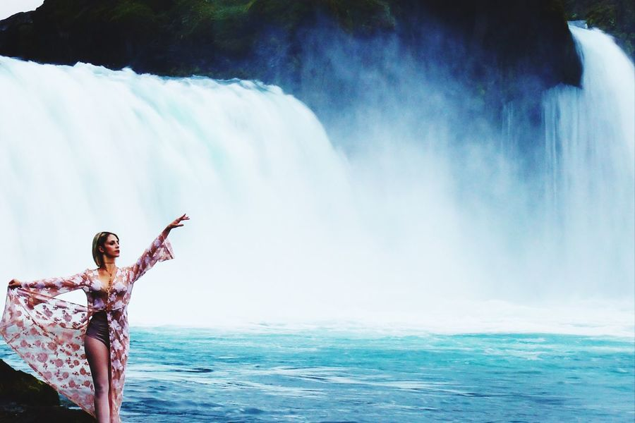 Posing at Godafoss. Water Young Adult One Person Young Women Outdoors Day Real People Vacations Leisure Activity Sea Standing Nature Beauty In Nature Lifestyles Motion Horizon Over Water Women Beautiful Woman Waterfall Full Length Iceland_collection God's Beauty Iceland