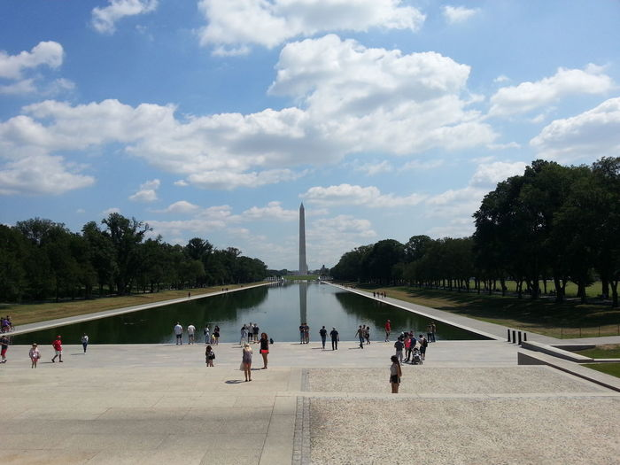 Tourists at lincoln memorial reflecting pool