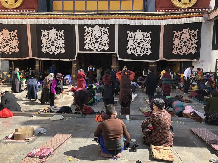 Group of people sitting outside temple