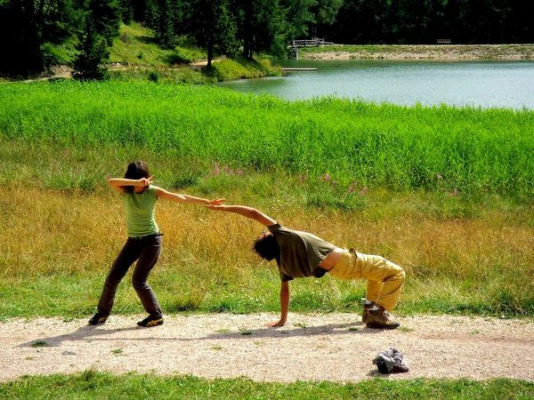 Playing Outdoors Leisure Time Dancing Enterteiment In The Park Couples Easygoing Stretching Out Jokingaround