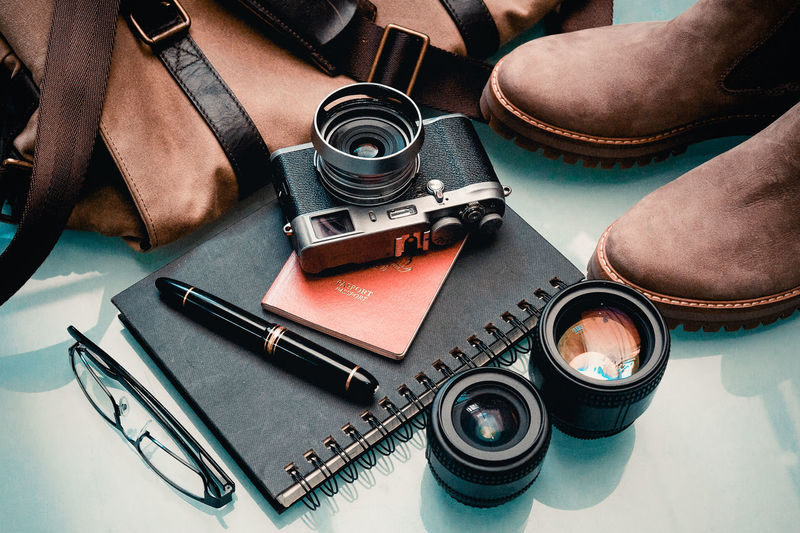 Still Life Travel Personal Accessory Retro Styled Digital Camera Camera People Fashion Choice Equipment Technology High Angle View Photography Themes Journey Note Book Fountain Pen Organising Out Of Town On A Trip Ready To Go Close-up Indoors