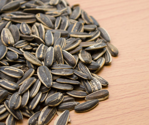 Close-Up Of Sunflower Seeds On Table