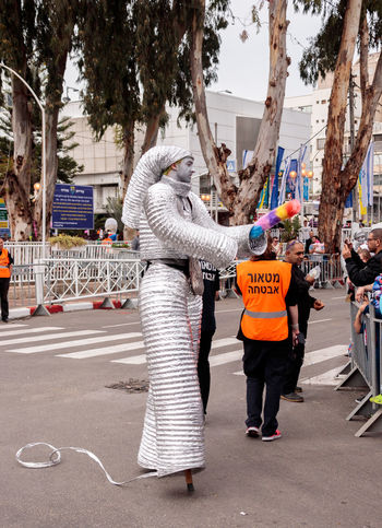 "Nahariyya, Israel, March 10, 2017: Participants at the traditional annual сarnival parade ""Adloyada"" dressed in robots are walking along the street in Nahariyya, Israel Adloyada Annual Attractive Beautiful Beauty Carnival Celebration Confident  Costume Day Dressed Event Holiday Human Israel Mask Modern Nahariyya Outdoors Parade Party People Street Style Traditional"