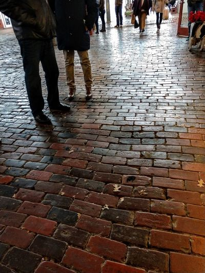 shopping City Low Section Pedestrian Human Leg Puddle Wet Walking Street Cobblestone Sidewalk