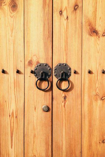 antique Wood door with door knocker Antique Backgrounds Brown Close-up Day Door Door Knocker Knocker Metalwork Lock No People Old-fashioned Outdoors Pattern Protection Safety Textured  Vintage Wood - Material
