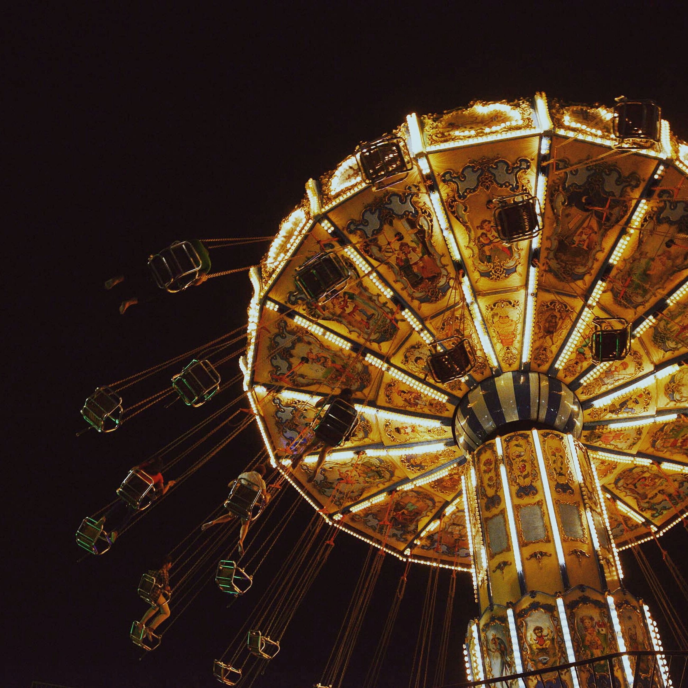 ferris wheel, amusement park ride, amusement park, arts culture and entertainment, architecture, built structure, night, illuminated, low angle view, travel destinations, famous place, capital cities, city, building exterior, international landmark, tourism, travel, sky, tall - high, modern