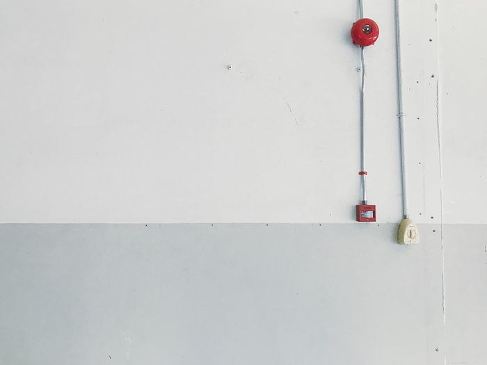 Close-up of red pipe on wall