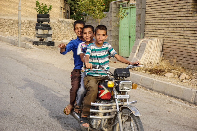 Iran Travel Destinations Travel Photography Nomadic Shia Community Travel Nomadic Life Two People Looking At Camera Males  Men Portrait Architecture Child Togetherness Boys Childhood Front View Adult Full Length Smiling Casual Clothing Built Structure Enjoyment Positive Emotion