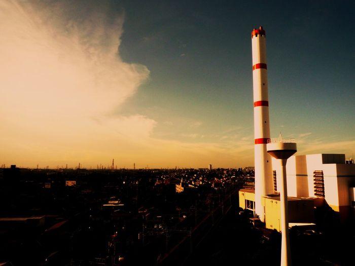 Incineration plant in neighborhood. EyeEm Best Shots - Architecture Plants Landscape City Cityscapes Landscape_Collection Chimney Factory Sunset Architecture
