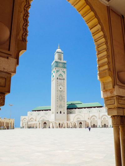 Mosque hassan ii seen through arch