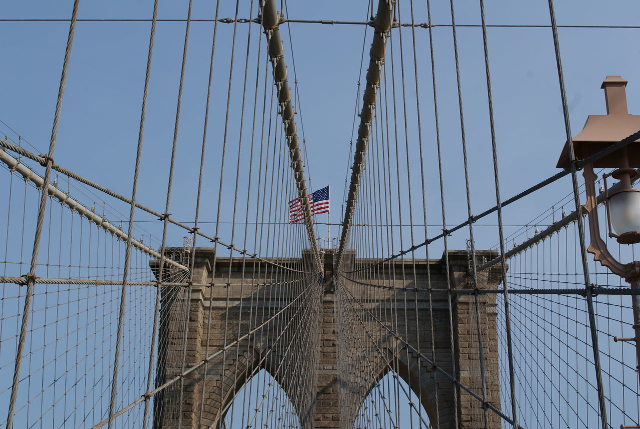 flag, patriotism, bridge, architecture, connection, bridge - man made structure, built structure, sky, suspension bridge, tourism, engineering, low angle view, travel, travel destinations, freedom, nature, independence, outdoors, national icon
