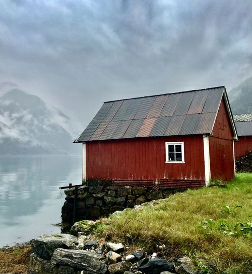 Simple Beauty Wanderlust Waterfront Hut Red Color Serenity Calm Peaceful Village Fjords Norway Rural Scene Travel Cloud - Sky Built Structure Architecture Sky Building Exterior Day Nature Building No People Water Outdoors