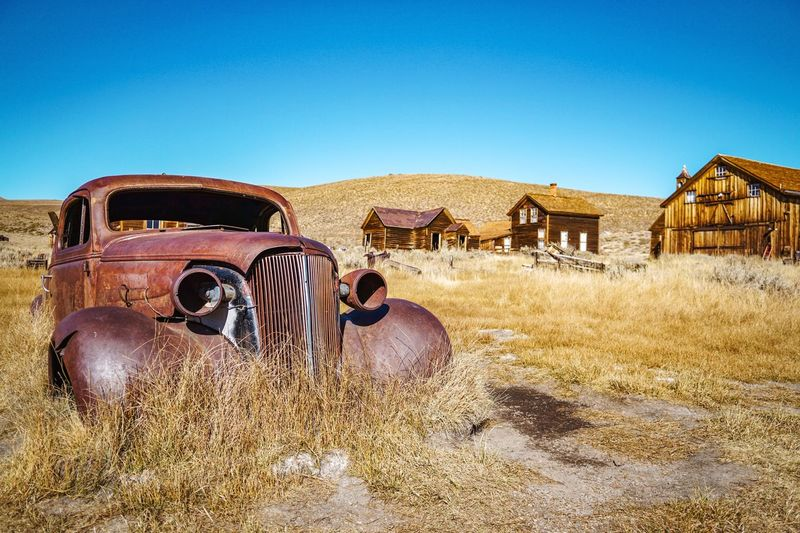 Old car in Bodie Car Damaged Rusty Metal Abandoned No People Outdoors Day Desert Blue Arid Climate Clear Sky