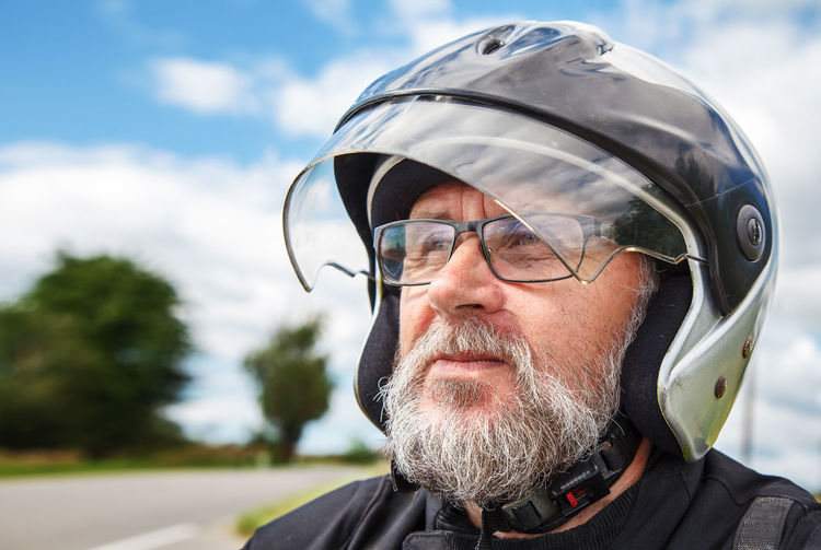 Close-up of man in helmet looking away