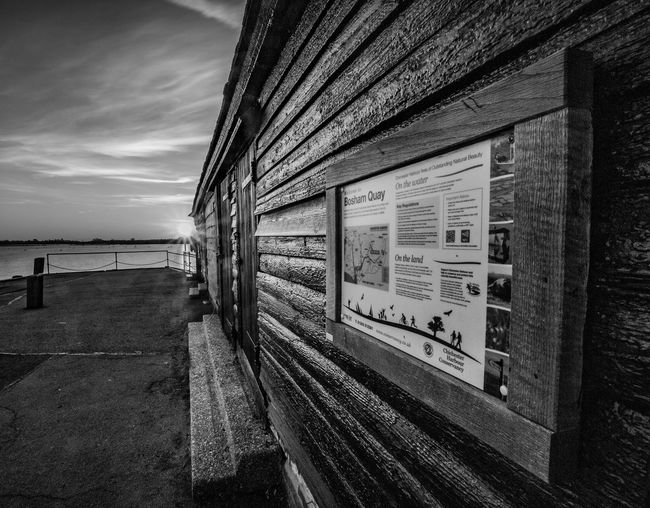 Down at the Quay Bosham Bosham Quay Bosham, W. Sussex Architecture Bosham Bosham Harbour Built Structure Clouds Day Information Sign Nature No People Outdoors Quay Sky Water Wooden Texture
