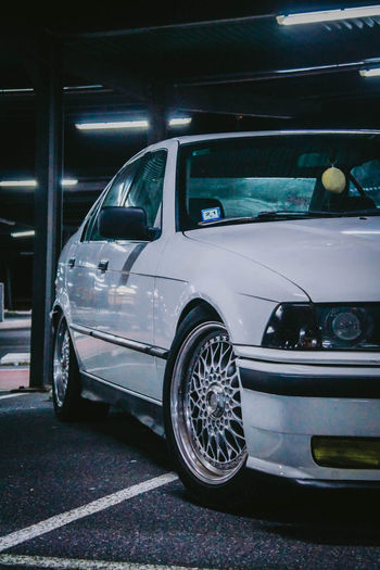 Bmw Mode Of Transportation Car Motor Vehicle Land Vehicle Transportation City No People Stationary Parking Parking Lot Street Night Retro Styled Architecture Road Illuminated Headlight Side View Outdoors Parking Garage Silver Colored