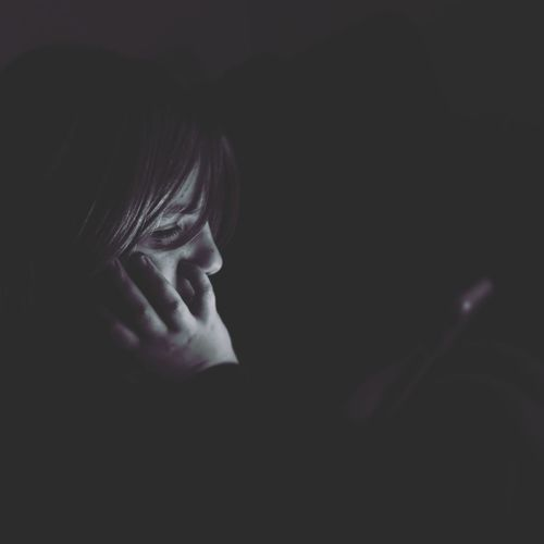 Tiny Screens Life 21st Century Night Black And White Light Young Headshot Human Face Close-up Thoughtful Thinking Plain Background Caucasian Pretty Film Noir Style