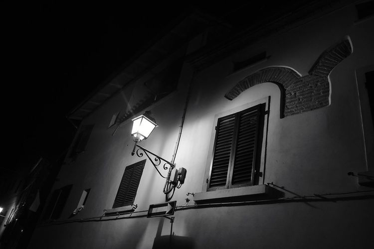 Walking alone late in the night - 3/4 Travel Travelling Beautiful Awesome_shots Photooftheday Blackandwhite Black And White Black & White EyeEmNewHere EyeEm Selects Lucignano Town HUAWEI Photo Award: After Dark Night Nightphotography Night Lights Night Photography Night View Nightshot Night Mood Illuminated Architecture Building Exterior Built Structure Street Light Wall Lamp Lamp Street Lamp