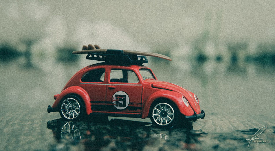 Toy car on road during rainy season