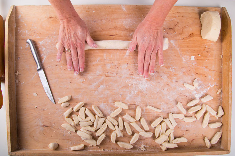 High angle view of human hand on cutting board