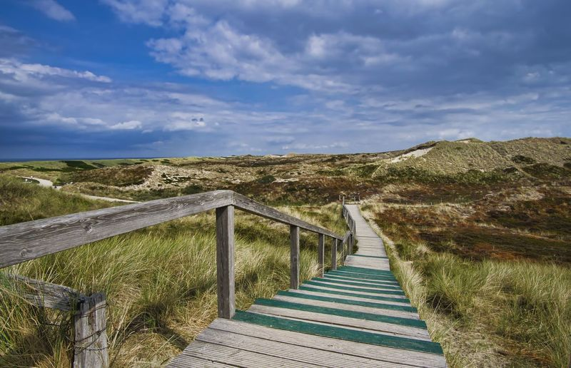 Sky Cloud - Sky The Way Forward Direction Landscape Grass Railing Nature Scenics - Nature Plant Land Day Environment Tranquil Scene Tranquility No People Beauty In Nature Footpath Non-urban Scene Architecture Outdoors Way Wooden Path Summer