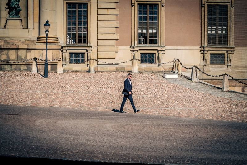 Full length of man walking in building