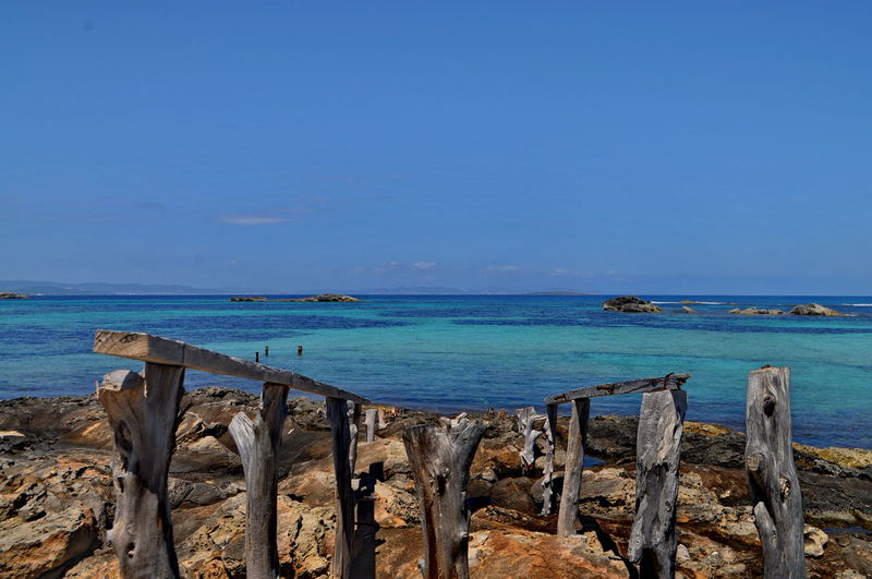 Formentera Sant Francesc Balearic Islands Beach Beauty In Nature Blue Blue Water Coastline Formentera Green Color Mediterranean Sea Nature Outdoors Pitusas Platja Des Pujols Sea Seascape Sky Turquoise Water Water Wood - Material Scenics Clear Sky Horizon Over Water Day