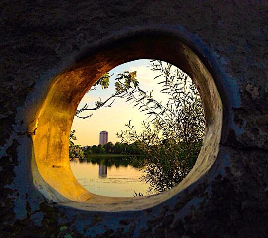 A hole in a Stone View Hole Texture Textures And Surfaces Sunset Architecture Water Reflection Built Structure Architecture Ladyphotographerofthemonth Shootermag Tree Sunset_collection Sunset Silhouettes Nature Landscape Nature Nature_collection Landscape_Collection Denmark Copenhagen Lake My Lake Building Exterior The Great Outdoors - 2017 EyeEm Awards The Street Photographer - 2017 EyeEm Awards The Architect - 2017 EyeEm Awards Paint The Town Yellow Been There. The Graphic City Stories From The City