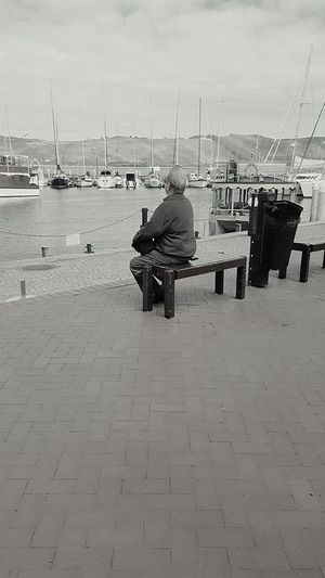 The Street Photographer - 2017 EyeEm Awards Sea Outdoors Transportation Sky Day One Man Only Adult Sitting Sailing Ship Nature Landscape Travel Beautiful Nature South Africa Reminiscing Calmwaters Knysna Sailboat Cloud - Sky Vacations Travel Destinations Tourism Water Tranquility The Portraitist - 2017 EyeEm Awards