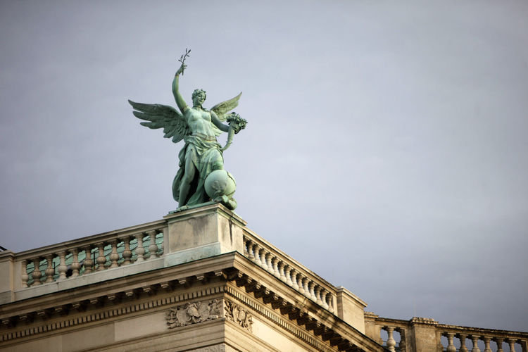 Low Angle View Of Angel Statue Against Sky At Hofburg Palace