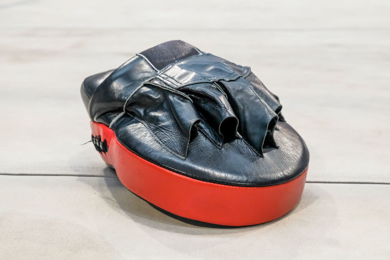 Bag Black Color Close-up Day Fashion Flooring Focus On Foreground High Angle View Indoors  Leather No People Pair Personal Accessory Red Shoe Shoelace Sport Sports Equipment Still Life