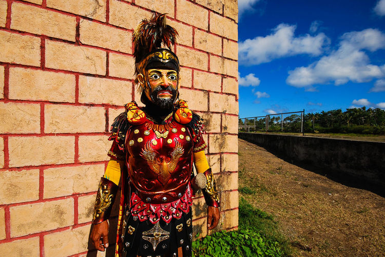 A Morion poses for a portrait during the Moriones Festival in Marinduque, Philippines. Architecture Brick Wall Built Structure Day Marinduque,Philippines Moriones Moriones Festival Outdoors Roman Soldier Romans Sky The Portraitist - 2017 EyeEm Awards EyeEmNewHere