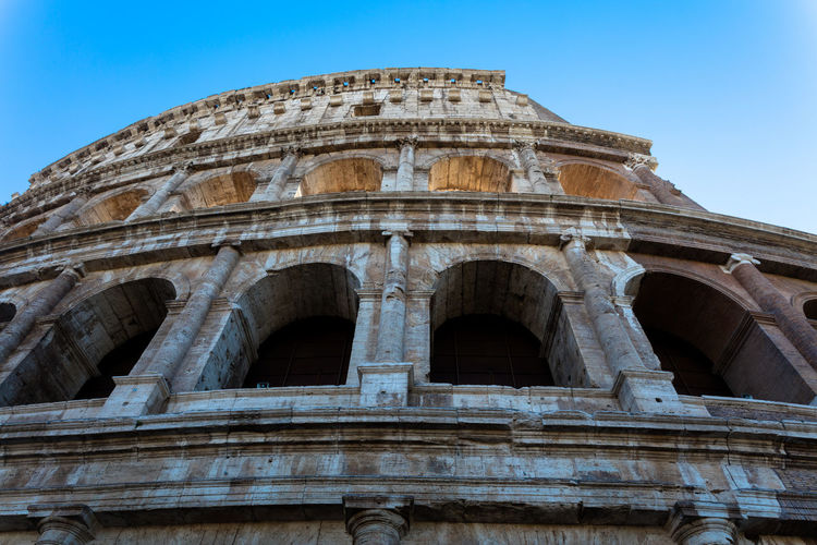Low angle view of arched structure against clear sky