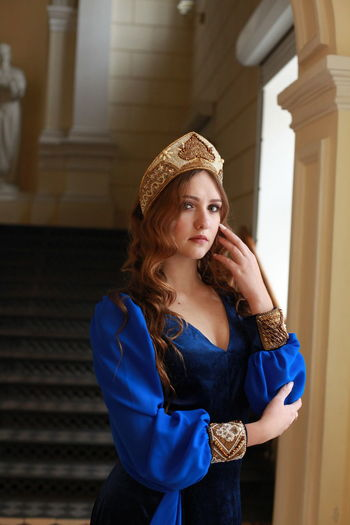 Looking At Camera Women Portrait Beauty Hairstyle Hair Blue Russian Russian Girl Russian Blue Medieval Traditional Traditional Clothing Staircase Three Quarter Length Clothing Indoors  Hat Focus On Foreground Front View Contemplation Fashion Standing