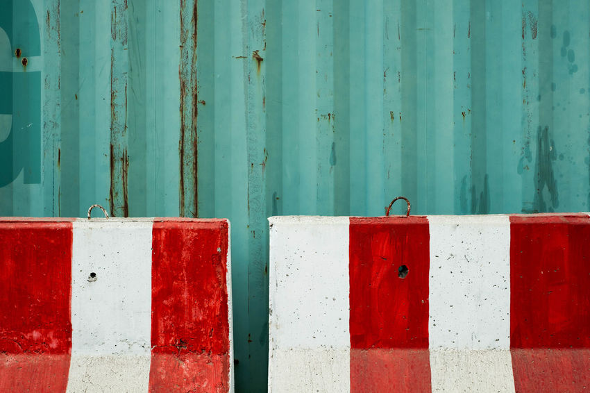 Green Containers And the concrete barrier. Container Green Color Architecture Backgrounds Barrier Built Structure Close-up Concrete Day Full Frame Green Color No People Outdoors Red Streelight Textured  Wood - Material
