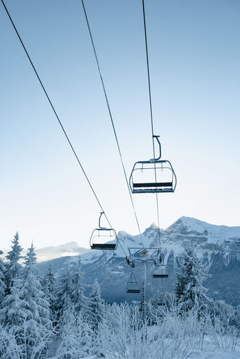 Cold Temperature Snow Winter Scenics - Nature Ski Lift Nature Beauty In Nature Mountain Sky No People Tranquility Cable Car Cable Tranquil Scene Non-urban Scene Overhead Cable Car Day Land White Color Outdoors Snowcapped Mountain Electricity  France Alps Ski Lift