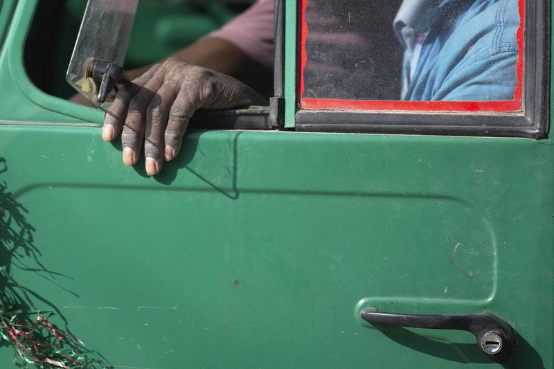 Midsection of man sitting in van