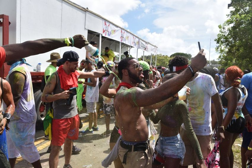 Jouvert Carnival Jouvert Miami Lauderhill Fun Casual Clothing Real People Enjoyment Men Spraying Lifestyles Holi Sky Adult People Outdoors Happiness Day Women Togetherness Crowd