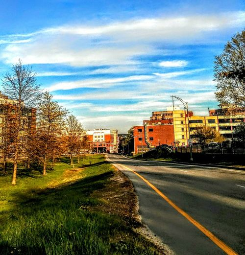 the road to amazing. ~ In Portland Maine USA Happiness Rays Of Light Nature_perfection Beauty In Nature Springtime Loving The Sky Blue No People Freedom! Nature Lover Color Of Life Loving The Landscape Lights And Reflection Tree Road City Sky Architecture Building Exterior Built Structure Cloud - Sky