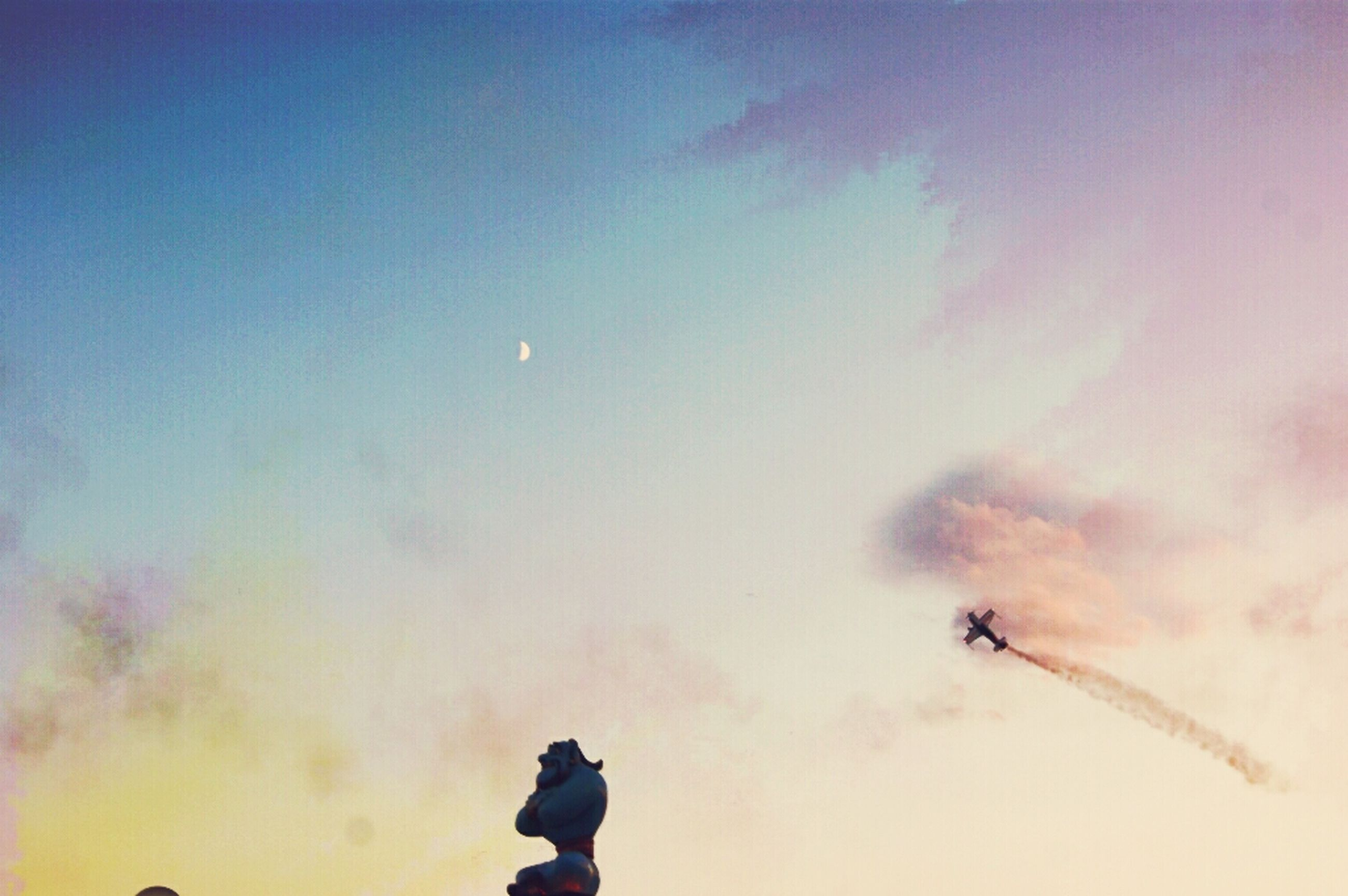 leisure activity, lifestyles, men, sky, low angle view, silhouette, unrecognizable person, adventure, sunset, fun, outdoors, cloud - sky, dusk, mid-air, extreme sports, enjoyment, nature, standing