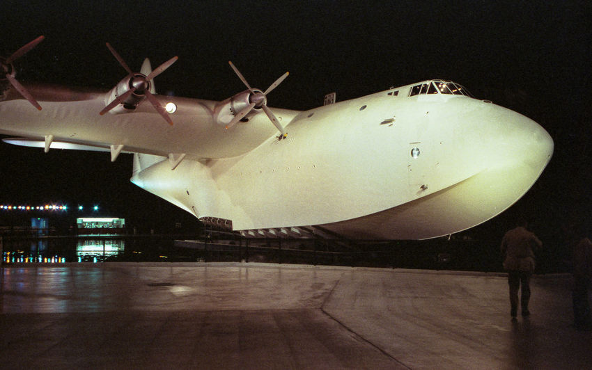 """Dec 1984 - The """"Spruce Goose"""" built in 1947 out of Beech wood; It flew only once. 8 Engines Aerospace Industry Air Vehicle Airplane Flight Illuminated MILITARY TRANSPORTATION Mode Of Transportation No People Propeller Record Holder Transportation Wooden Aircraft"""