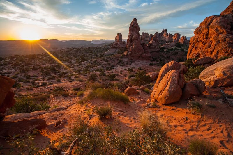 Scenic view of arches national park against sky during sunset