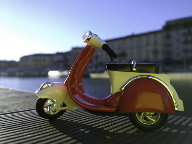 vespa model parcked by navigli in milan Close-up Day Focus On Foreground Italy Holidays Italy❤️ Mode Of Transport Model Nature No People Outdoors Selective Focus Sky Stationary VESPA Bella Vespa Motorcycle Vespavintage Yellow