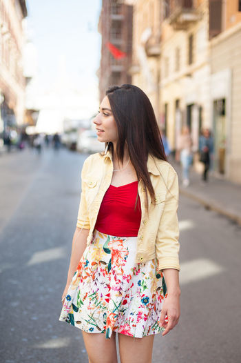 Young woman walking for shopping in city street Brown Hair Casual Clothing City City City Life Day Focus On Foreground Leisure Activity Lifestyles Long Hair Outdoors Standing Street Streetphotography Walking