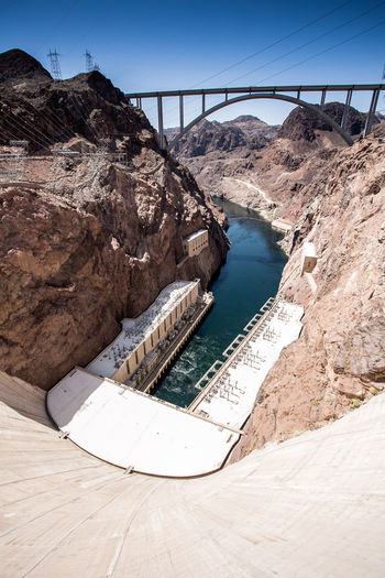 High angle view of hover dam amidst mountains